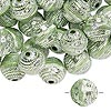 Bead, acrylic, green and silver, 11mm round with line design, 2mm hole. Sold per pkg of 100.