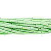 Bugle bead, Preciosa® Czech glass, opaque pale green, #3 with round hole. Sold per 1/2 kilogram pkg.