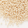 Seed bead, Delica®, glass, opaque luster light beige, (DB204), #11 round. Sold per pkg of 7.5 grams.