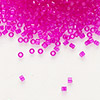 Seed bead, Delica®, glass, transparent hot pink, (DB1310), #11 round. Sold per 50-gram pkg.