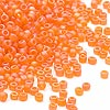 Seed bead, Dyna-Mites™, glass, frosted rainbow orange, #11 round. Sold per 40-gram pkg.