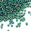 Seed bead, Dyna-Mites™, glass, silver-lined rainbow dark green, #11 round with square hole. Sold per 1/2 kilogram pkg.