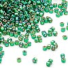 Seed bead, Dyna-Mites™, glass, silver-lined rainbow emerald green, #11 round with square hole. Sold per 40-gram pkg.