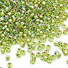 Seed bead, Dyna-Mites™, glass, silver-lined rainbow light green, #11 round with square hole. Sold per 40-gram pkg.