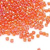 Seed bead, Dyna-Mites™, glass, transparent rainbow orange, #11 round. Sold per 40-gram pkg.