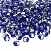 Seed bead, glass, two-toned silver-lined cobalt blue/silver, 3-4mm irregular round. Sold per pkg of 250 grams.