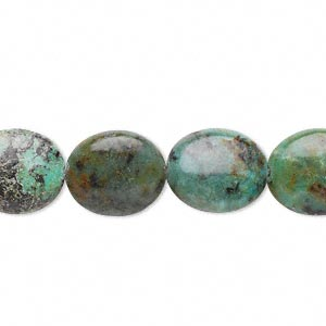 bead, african turquoise (dyed), 14x12mm flat oval, c grade, mohs hardness 6-1/2 to 7. sold per 16-inch strand.