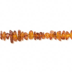 bead, amber (heated), medium, medium chip, b grade, mohs hardness 2 to 2-1/2. sold per 16-inch strand.