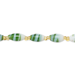 bead and seed bead mix, vintage india glass, silver-lined transparent gold / opaque white / green, #11 round and 8x4mm-10x6mm oval with swirl design. sold per 22-inch strand.
