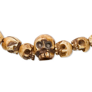 bead, bone (dyed), antiqued, hand-carved skull, mohs hardness 2-1/2. sold per 42-inch strand, approximately 100 beads.
