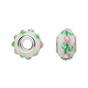 bead, dione, lampworked glass with silver-plated steel grommets, white / pink / green, 14x10mm bumpy rondelle with flowers, 4.5-5mm hole. sold per pkg of 6.