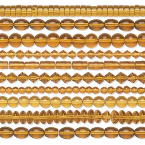 bead, glass, transparent honey, 5mm-11x8mm mixed shapes. sold per pkg of (10) 16-inch strands.