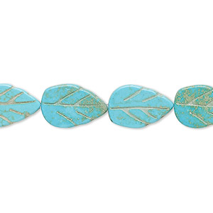 bead, magnesite (dyed / stabilized), blue-green, 13x8mm-14x9mm carved leaf, c grade, mohs hardness 3-1/2 to 4. sold per 15-inch strand.