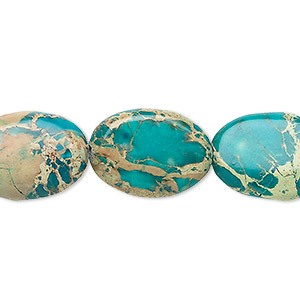 bead, magnesite (dyed / stabilized), turquoise blue, 18x13mm flat oval, b grade, mohs hardness 3-1/2 to 4. sold per 16-inch strand.