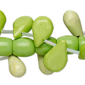 bead mix, magnesite (dyed / stabilized), lime green, 6x6mm-30x15mm mixed shape, d grade, mohs hardness 3-1/2 to 4. sold per pkg of (3) 15-inch strands.