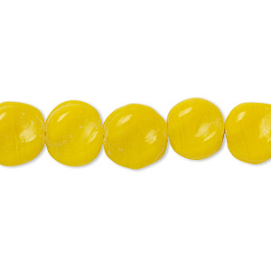 bead, vintage india glass, opaque yellow, 9-11mm twisted flat round. sold per 18-inch strand.