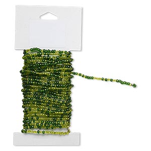 beaded wire, glass and brass, silver-lined green and light green, #9 and #6 round seed beads. sold per 15-foot card with hanging tab.