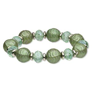 bracelet, stretch, acrylic / glass / silver-coated plastic, green, faceted rondelle, 8 inches. sold individually.