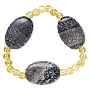 bracelet, stretch, picasso marble (natural) and acrylic, yellow, 5mm round and 29x20mm-30x20mm flat oval, 6-1/2 inches. sold individually.