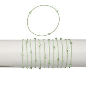 bracelet, stretch, plastic and brass, metallic green, coil with 2.5mm and 4mm round, 7 inches. sold per pkg of 12.