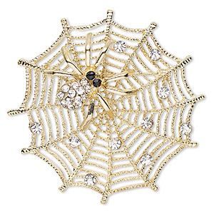 brooch, glass rhinestone and gold-finished pewter (zinc-based alloy), clear and black, 58x58mm web with spider. sold individually.