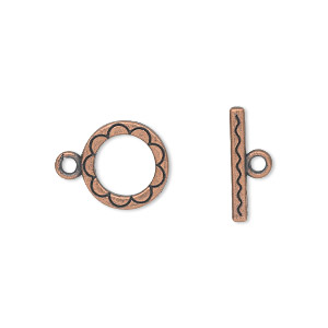 clasp, toggle, antique copper-plated pewter (zinc-based alloy), 12mm double-sided round with flower design. sold per pkg of 20.