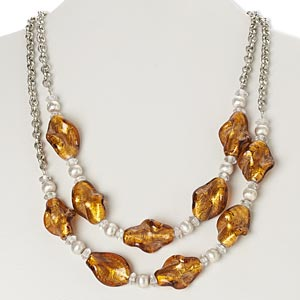 necklace, lampworked glass / silver-finished brass / steel, honey and clear with silver-colored foil, brushed twisted oval, 38-inch continuous loop. sold individually.