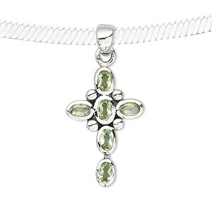 pendant, peridot (natural) and sterling silver, 27x12mm cross with 5x3mm faceted oval. sold individually.
