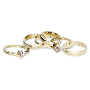 ring mix, glass rhinestone and gold-finished brass, clear and pink, 4mm and 7mm wide, size 5 to 12-1/2. sold per pkg of 6.