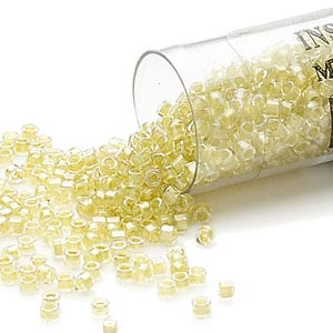 seed bead, delica, glass, color-lined light chartreuse, (db910), #11 round. sold per 7.5-gram pkg.