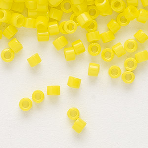 seed bead, delica, glass, opaque yellow, (db721), #11 round. sold per pkg of 250 grams.