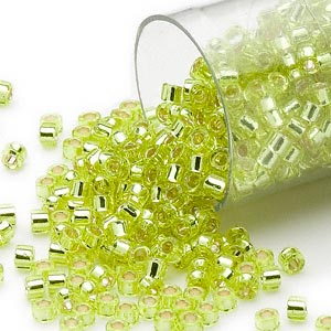 seed bead, delica, glass, silver-lined lime yellow, (db147), #11 round. sold per 7.5-gram pkg.