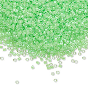 seed bead, delica, glass, transparent luminous color-lined neon lime green, (db2040), #11 round. sold per 7.5-gram pkg.