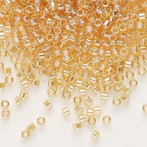 seed bead, delica, glass, transparent luster light amber yellow, (db99), #11 round. sold per 7.5-gram pkg.