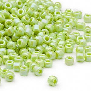 seed bead, dyna-mites™, glass, opaque rainbow light green, #6 round. sold per 1/2 kilogram pkg.