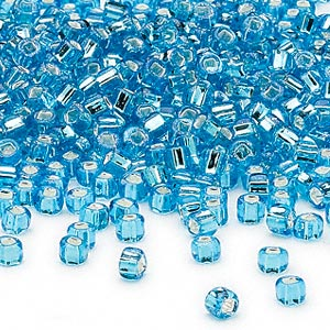 seed bead, dyna-mites™, glass, silver-lined translucent aqua, #6 round with square hole. sold per 1/2 kilogram pkg.