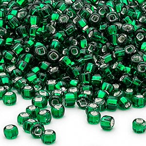 seed bead, dyna-mites™, glass, silver-lined translucent emerald green, #6 round with square hole. sold per 1/2 kilogram pkg.