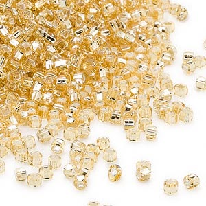 seed bead, dyna-mites™, glass, silver-lined translucent light gold, #11 round with square hole. sold per 40-gram pkg.