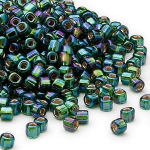 seed bead, dyna-mites™, glass, silver-lined translucent rainbow dark green, #6 round with square hole. sold per 1/2 kilogram pkg.
