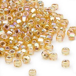 seed bead, dyna-mites™, glass, silver-lined translucent rainbow gold, #6 round with square hole. sold per 40-gram pkg.