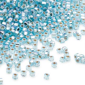 seed bead, dyna-mites™, glass, silver-lined translucent rainbow light aqua, #11 round with square hole. sold per 40-gram pkg.