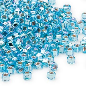 seed bead, dyna-mites™, glass, silver-lined translucent rainbow light aqua, #6 round with square hole. sold per 1/2 kilogram pkg.