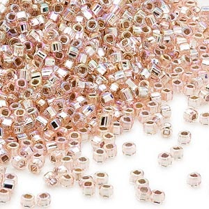 seed bead, dyna-mites™, glass, silver-lined translucent rainbow light pink, #11 round with square hole. sold per 40-gram pkg.