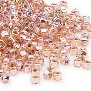 seed bead, dyna-mites™, glass, silver-lined translucent rainbow light pink, #6 round with square hole. sold per 40-gram pkg.