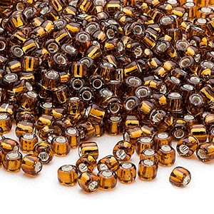 seed bead, dyna-mites™, glass, silver-lined translucent root beer, #6 round. sold per 1/2 kilogram pkg.