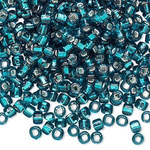 seed bead, dyna-mites™, glass, silver-lined translucent teal blue, #6 round with square hole. sold per 40-gram pkg.