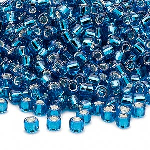 seed bead, dyna-mites™, glass, silver-lined translucent turquoise blue, #6 round. sold per 1/2 kilogram pkg.