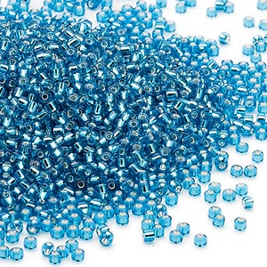 seed bead, dyna-mites™, glass, silver-lined transparent turquoise blue, #11 round. sold per 1/2 kilogram pkg.