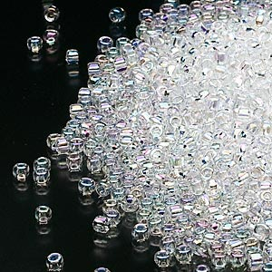 seed bead, dyna-mites™, glass, transparent rainbow clear, #11 round. sold per 1/2 kilogram pkg.