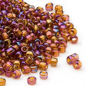seed bead, dyna-mites™, glass, transparent rainbow root beer, #6 round. sold per 1/2 kilogram pkg.